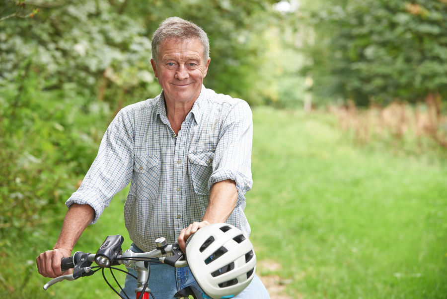 man enjoying bike ride in countryside