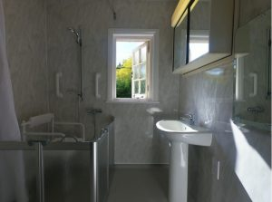 wet room style bathroom for someone with motor neurone disease