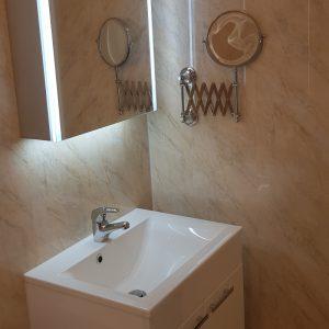 lit vanity unit in accessible bathroom