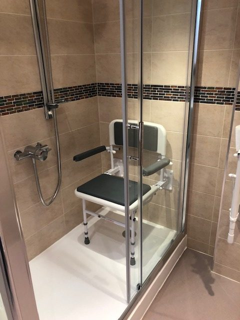 easy access shower with seat for safer bathing