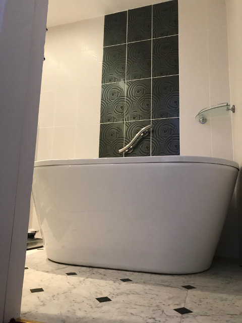 old hard to access bathtub