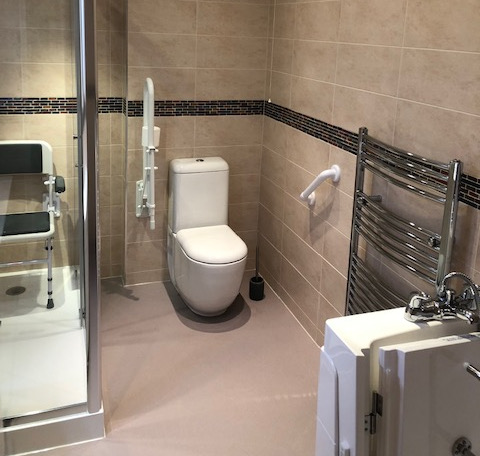 accessible bathroom with walk in shower and bath