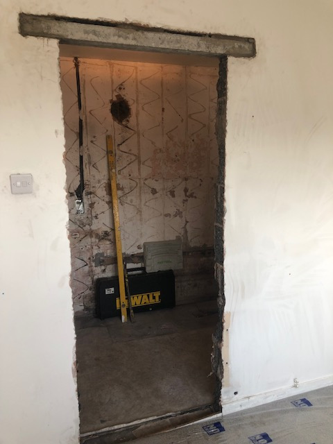 new wider doorway to bathroom