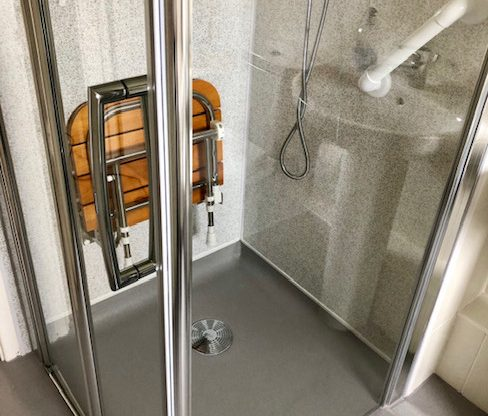 new walk in shower with level access